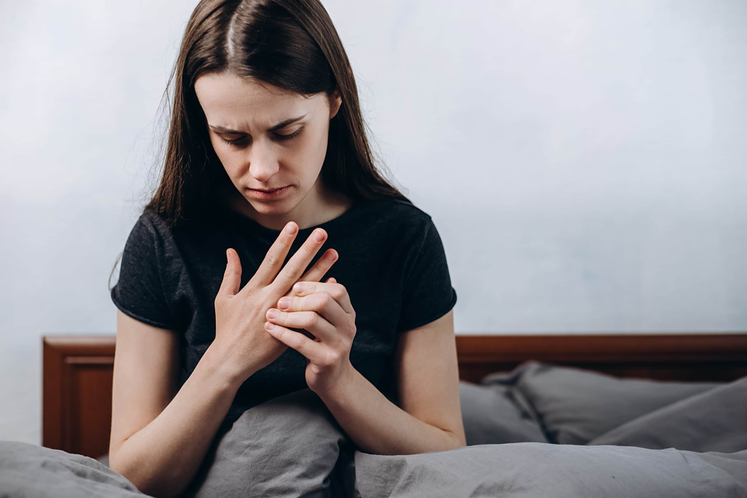 cbd oil for gout woman hand pain