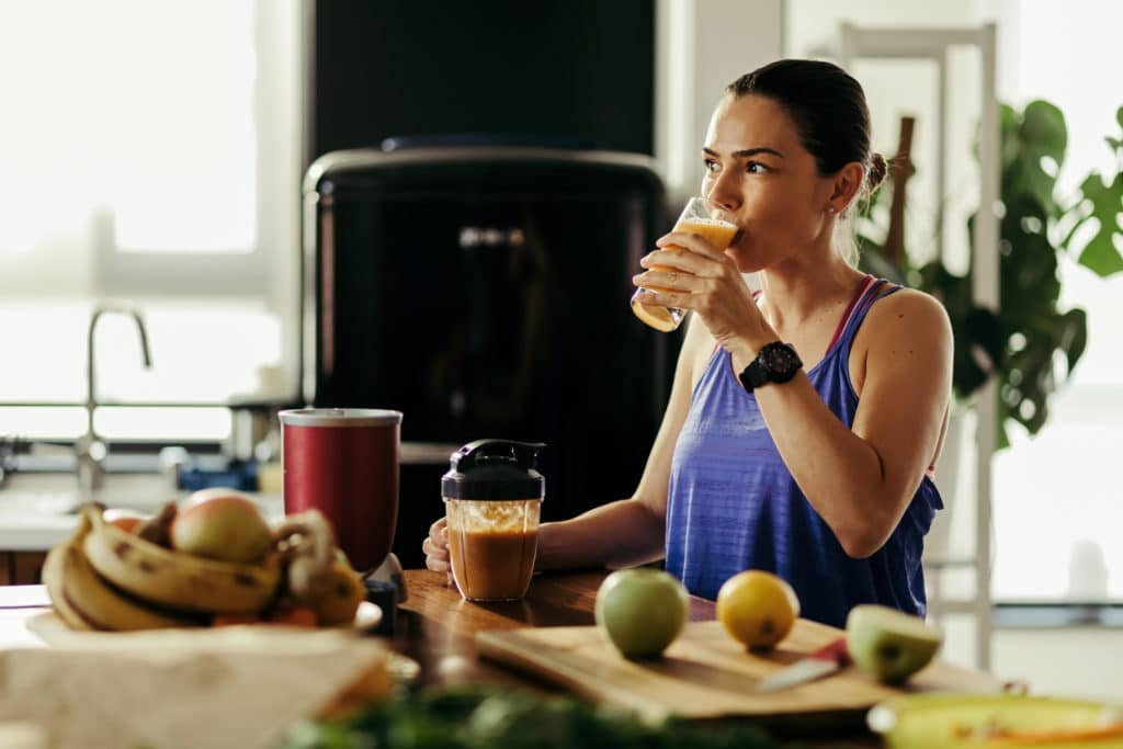 Young woman drinking CBD for weight loss
